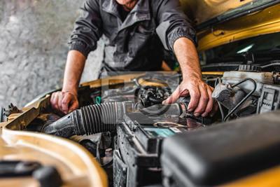 Fototapete  Car service worker repairing vehicle