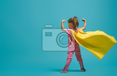 Fototapete child playing superhero
