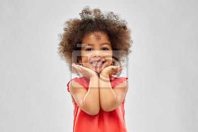 Fototapete childhood and people concept - happy little african american girl over grey background