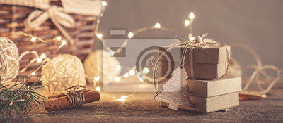 Fototapete Christmas and zero waste, eco friendly packaging gifts in kraft paper on a wooden table, eco christmas holiday concept, eco decor banner