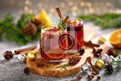 Fototapete Christmas mulled wine. Traditional Xmas festive drink with decorations and fir tree
