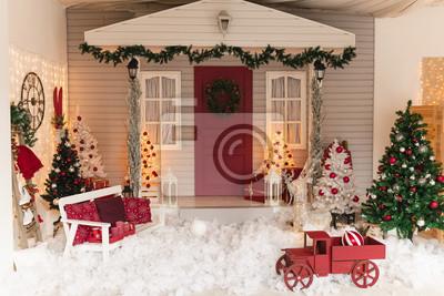 Fototapete Christmas veranda decorations. Street christmas decor with artificial snow.