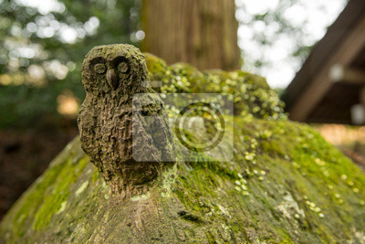 Close Up Detail Of An Ancient Owl Statue Carved From Stone Covered