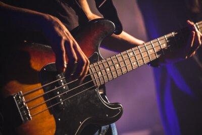 Fototapete Close-up Foto von Bass-Gitarrist