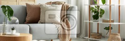 Fototapete Close-up of gray comfortable sofa in modern apartment - panorama