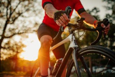 Fototapete Close up of man riding bike