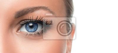 Fototapete Close up photo of a woman's blue eye