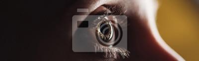 Fototapete close up view of human eye looking away in darkness, panoramic shot