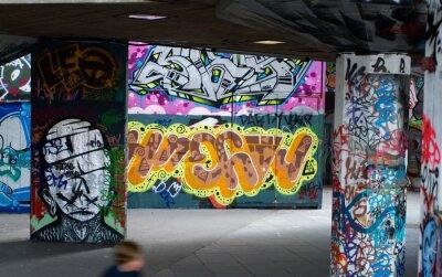 Fototapete colorful graffiti under a bridge