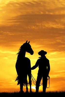 Fototapete Cowboy mit Pferd bei Sonnenuntergang
