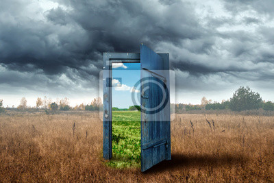 Fototapete Creative background. Old wooden door, blue color, in the box. Transition to a different climate. The concept of climate change, portal, magic. Copy space.