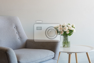 Cropped View Of Retro Armchair And Roses In Glass Jar On Small