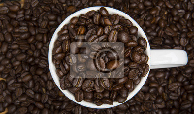 Cup of Coffee Beans Surrounded by Coffee Beans High Angle View