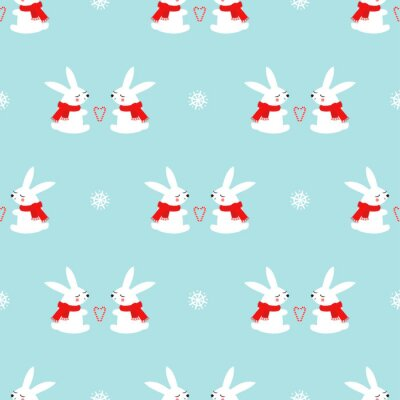 Fototapete Cute baby rabbits with candy cane hearts and snowflakes seamless pattern on blue background. Winter holidays background. Vector winter design for textile, wrapping paper, fabric, card.