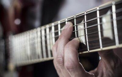 Fototapete Dedos sobre diapasón de guitarra