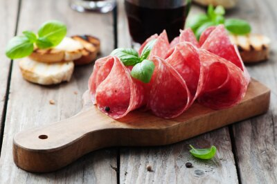 Fototapete Delicious salami with basil and wine