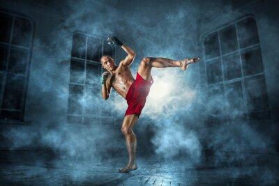 Fototapete Der junge Mann Kickboxen