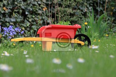 fototapete der kleine gartner gartnerin kinderschubkarre im garten