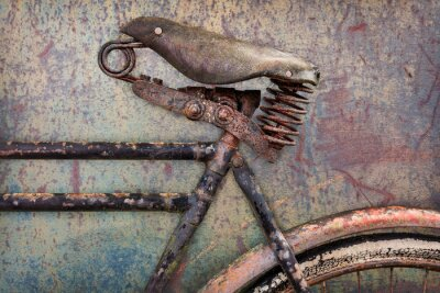 Fototapete Detail of a rusted ancient bicycle with leather seat