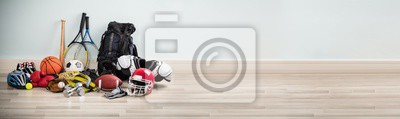 Fototapete Different Type Of Sports Equipment On Wooden Desk