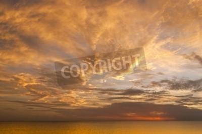 Fototapete Dramatische Sonnenuntergang Himmel mit Wolken über dem Ozean