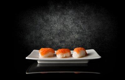 Fototapete Drei Sushi auf schwarz