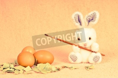 Easter rabbit in retro photo effect going to paint eggs