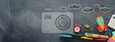 Fototapete education. Back to school concept. rocket cut from paper and painted over blackboard background. top view, flat lay. banner