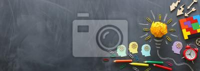 Fototapete Education concept image. Creative idea and innovation. Crumpled paper as light bulb metaphor over blackboard