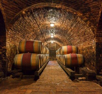 Fototapete Eichenfässer in einem unterirdischen Weinkeller
