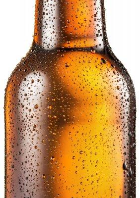 Fototapete Eine kalte Flasche Bier mit kondensiertem Wasser fällt darauf.