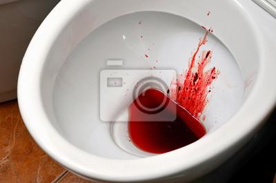 Eine weiße keramische toilettenschüssel ist mit blut ...