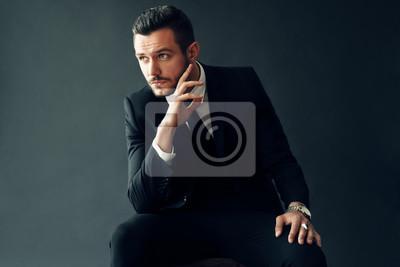 Fototapete Elegant young man portrait on black background