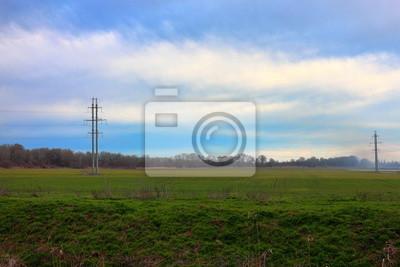Fototapete Elektrische Leitung Der Hochspannungsenergie 110 KV In Der  Idyllischen Natur Mit Wiese, Bewölktem Himmel