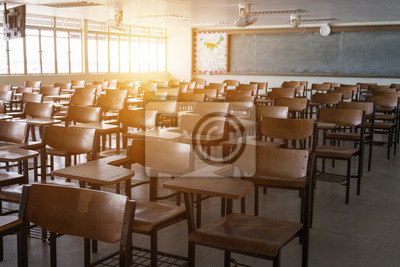 Fototapete Empty classroom with vintage tone wooden chairs. Back to school concept.