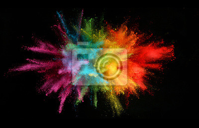 Fototapete Explosion of colored powder isolated on black background