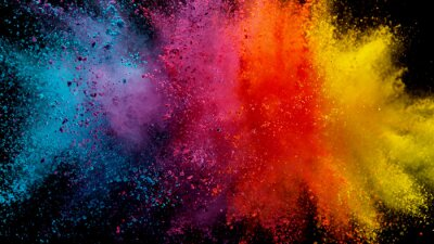 Fototapete Explosion of colored powder on black background