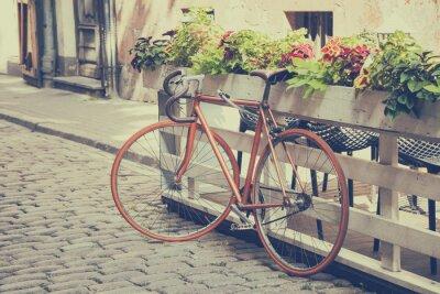 Fototapete Fahrrad auf der alten Straße. Jahrgang stilisierte.