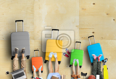 Fototapete Family is going on a trip, five colored suitcases with clothes and accessories for recreation.