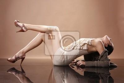 Fashionable brunette on mirrored floor