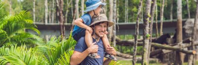 Fototapete Father and son at the zoo. Spending day with family at the zoo BANNER, long format
