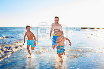 Father and Sons Playing at the Beach