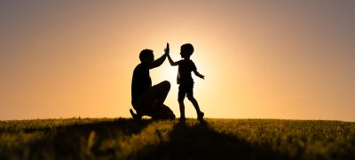 Fototapete Father giving son high five. Parent child relationship concept