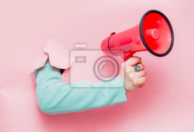 Fototapete Female hand in classic blue jacket with megaphone