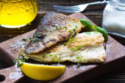 Fototapete Fischfilet mit Olivenöl und Zitrone