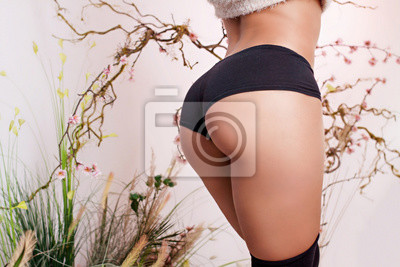 Fototapete Fit body. Beautiful female butt.