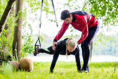 Fototapete Fitness und sport - Paar beim Sling Training
