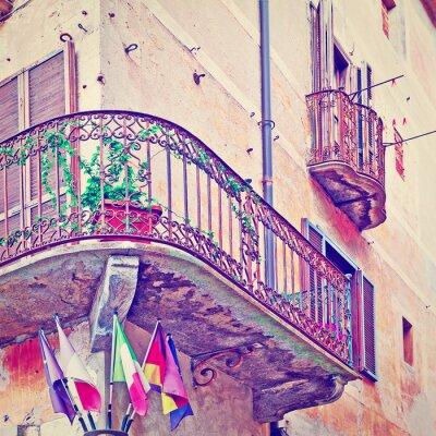 Fototapete Flags under Balcony