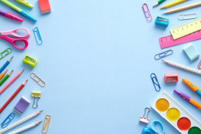 Fototapete Flat lay colorful school supplies on blue background. Back to school concept. Top view, overhead.