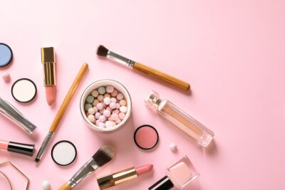 Fototapete Flat lay composition with products for decorative makeup on pastel pink background
